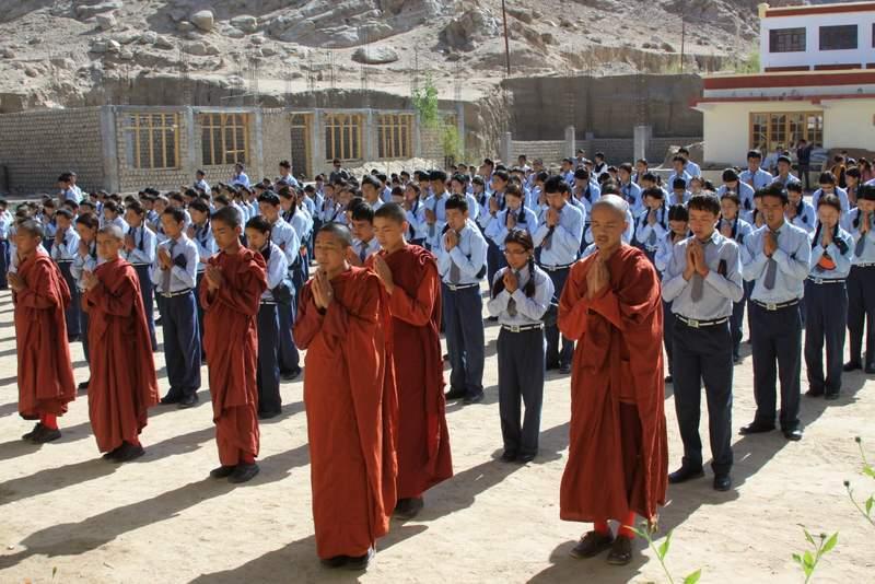 Spiritual Warriors - children and monks in courtyard