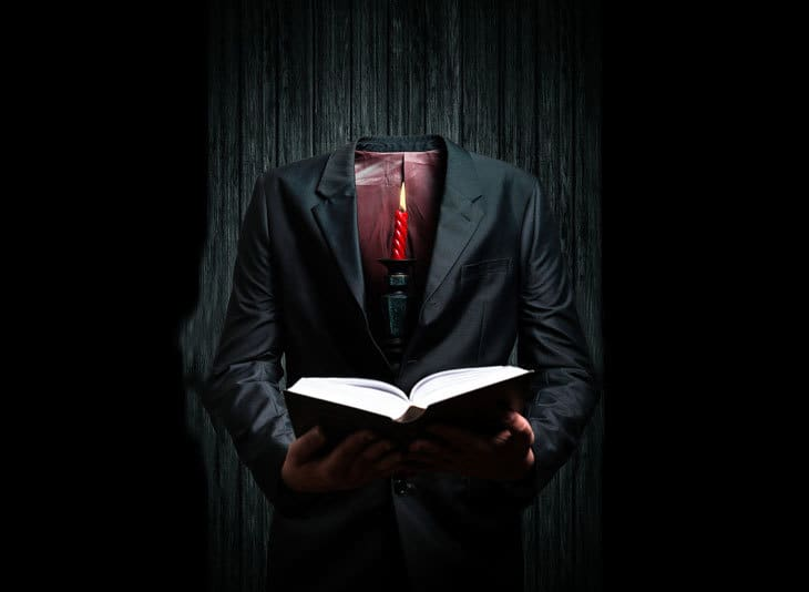 Headless man reading
