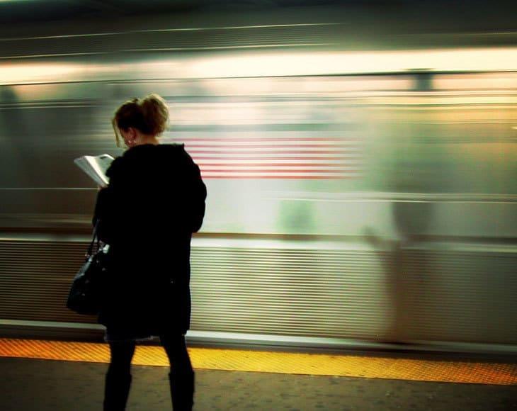 Reading book on subway platform - mindfulness training & staying focused