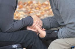 close up of man and woman - holding hands