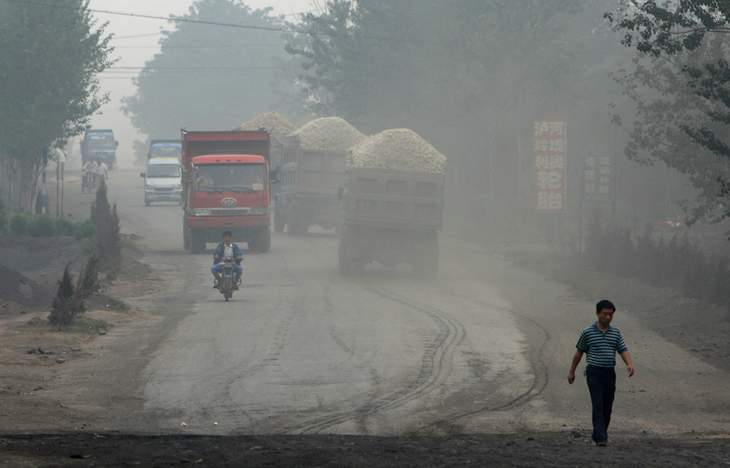 Trucks on road - The Dirtiest Place on the Planet