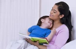 Mother reading book to child