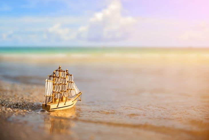 Model sailboat on ocean
