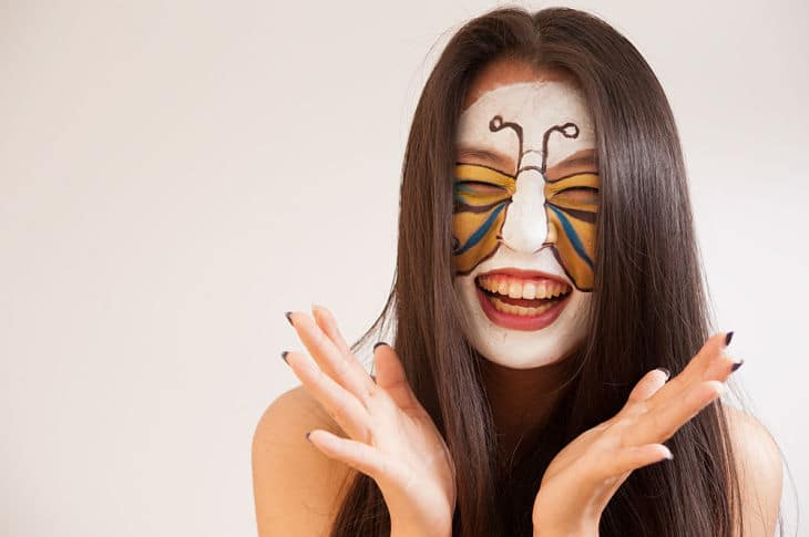 Happy, healthy face smiling with butterfly paint