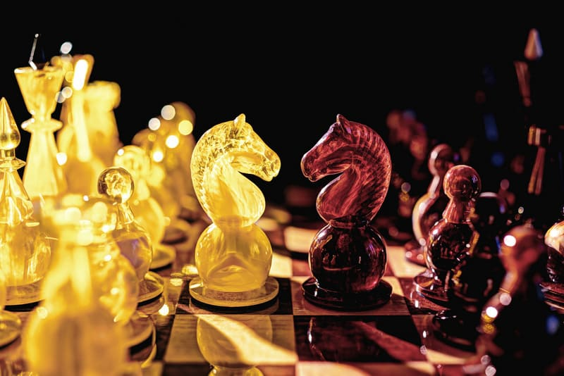 Chess board with two opposite knights confronting each other