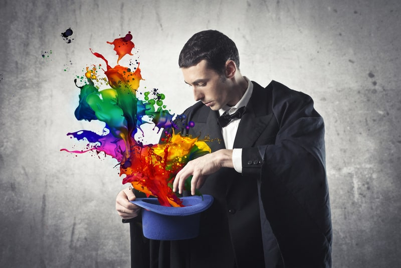 Magician pulling colours out of a hat