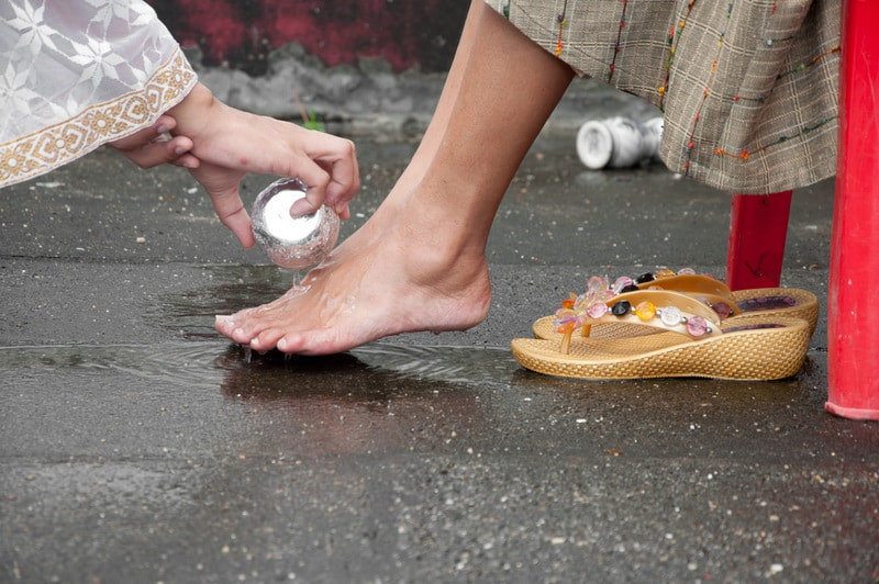 Buddhist monk washing mother's feet