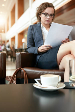 Businesswoman reading document - A trip to remember