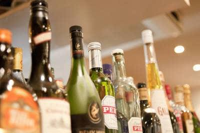 Liquor bottles on store shelf - A trip to remember