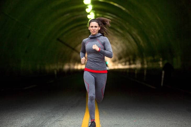 Woman jogging powerfully - Mastering Your Mean Girl