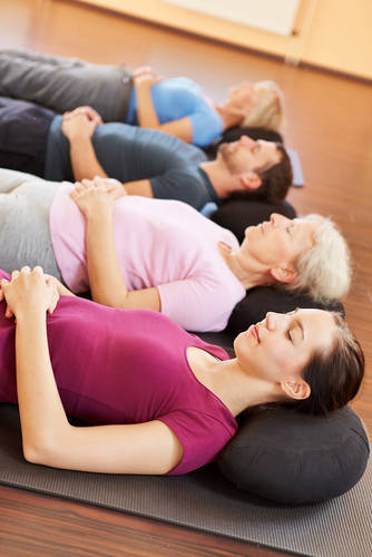 """Yoga students in savasana pose - Life in """"high definition"""""""