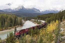 Freight train moving alongside river - Poems by Emma Sedlak