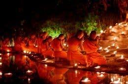 large group of Buddhist monks meditating