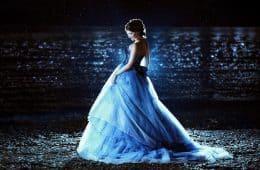 woman in a dark blue evening dress