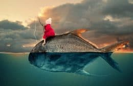 Photo manipulation of little girl fishing on the back of a huge fish