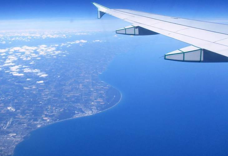 Airplane flying over land - The world that is there for us