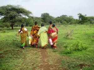 Women in India walking in colourful garments - The world that is there for us