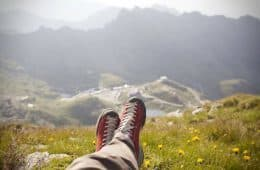 Traveller's feet while relaxing on mountaintop - Poems by Mike Larcombe
