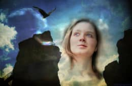 Woman's face looking at clouds and cliffs - The elusiveness of mindful awareness