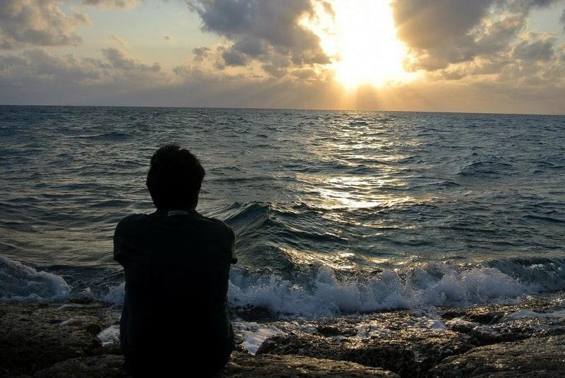 Man sitting staring at the sea