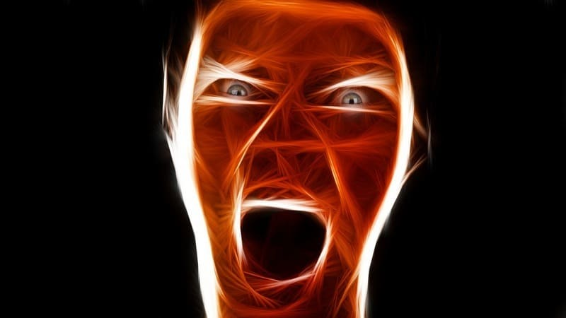 Drawing of angry face on black background