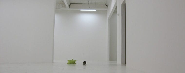 empty white room with green apple on the floor
