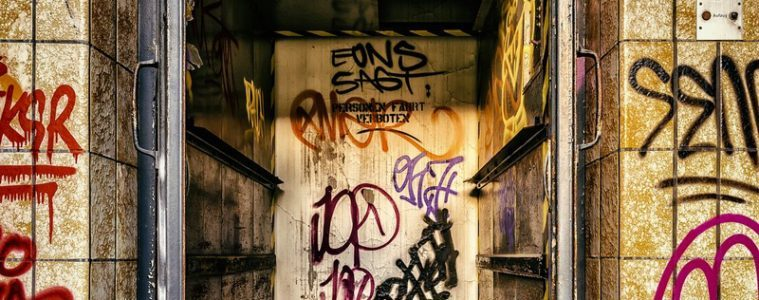 Elevator in abandoned building covered in grafiti