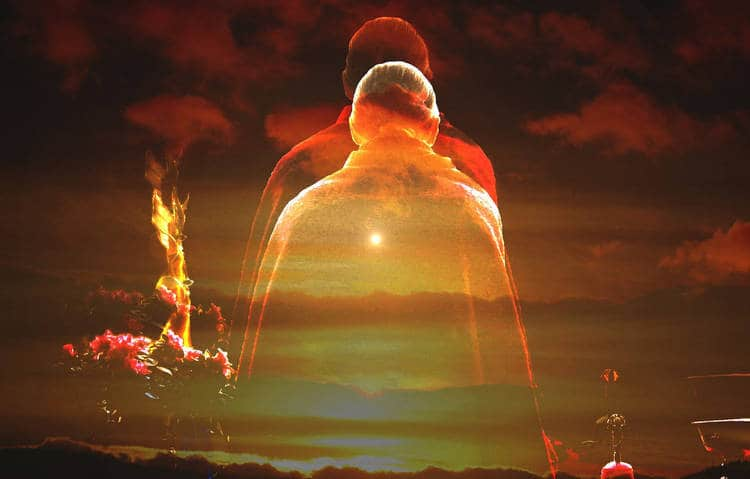 Abstract Buddhist figure against red-tinted sky - The death of identity