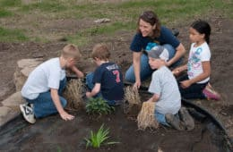 Four kids in park with caregiver - Kids, compassion and the environment