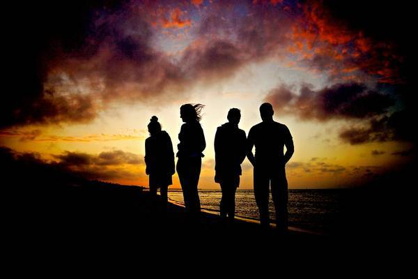 Four human silhouettes at sunset - The death of identity