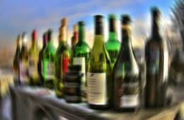 Blurry row of alcohol bottles - Thanking Anne Lamott