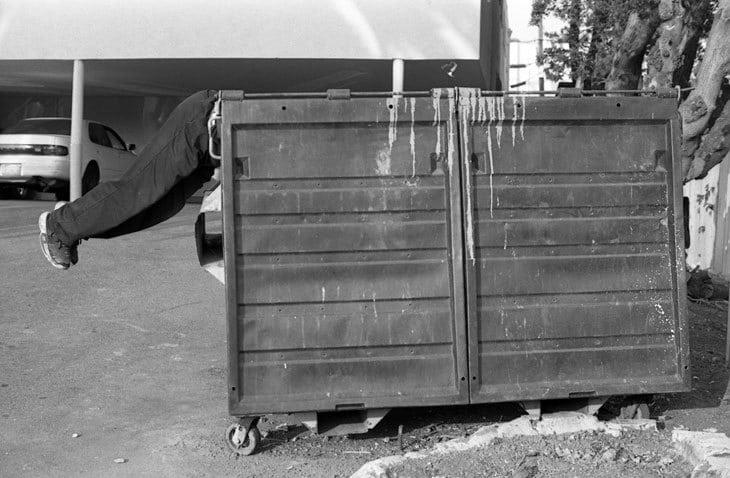 Man dumpster diving