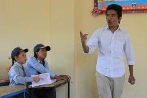 Spiritual Warriors - teacher teaching boys in classroom
