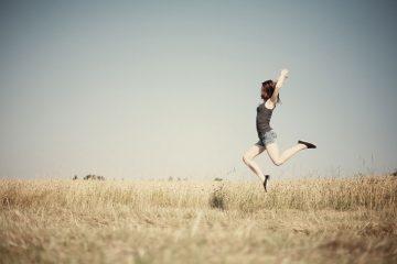 Dancer in field dancing alone