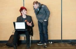 Online activism - activist talking to man with laptop