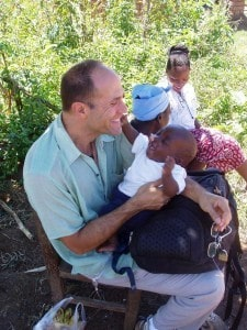 People Who Care: Dr. Cary Rasof - cuddling a baby in Zambia