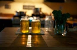 Two bottles of ghee on table (clarified butter)