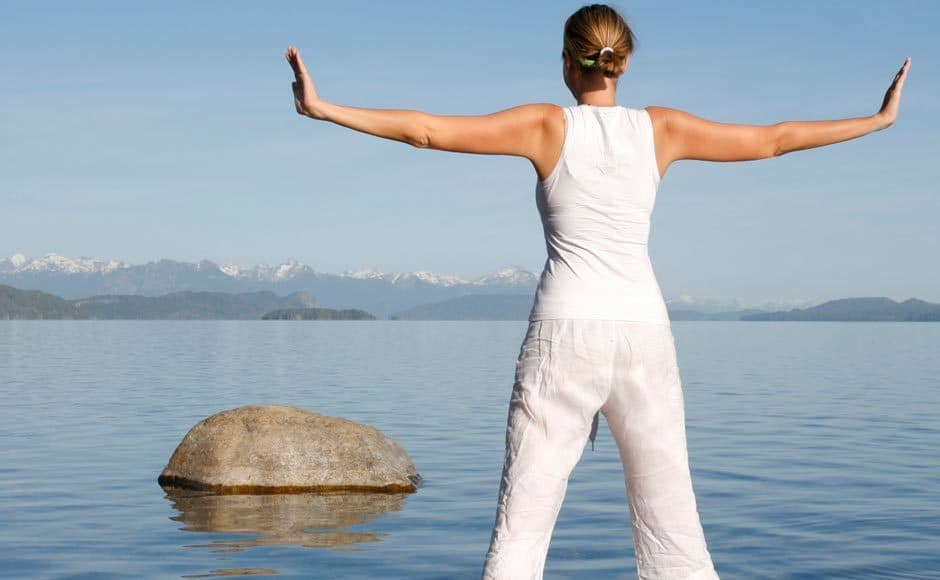 Woman at lake - meditation and stress