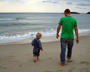 Father and son on beach - intentional parenting