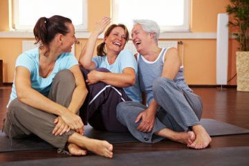 laughter yoga benefits - three women laughing
