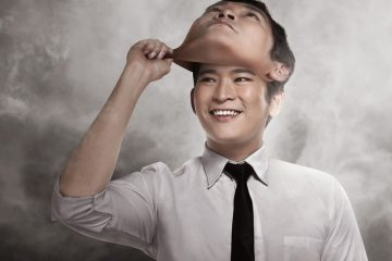 ego - man taking off mask