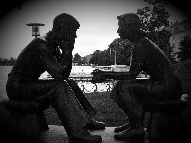 Statue of couple communicating - beginning anew