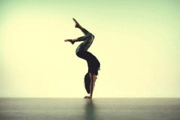 Dancer yogi doing hand stand