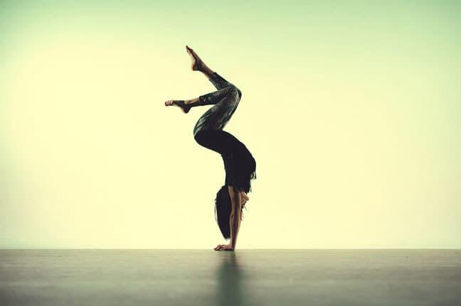 Dancer yogi doing hand stand