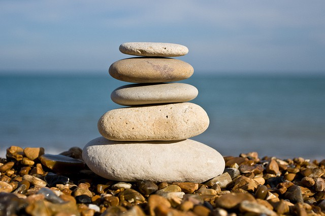 Alignment. Image pile of stones on a pebble beach