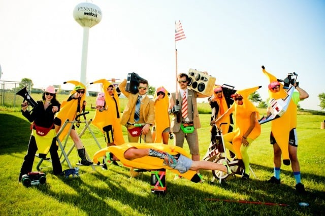 party-revolution. Image group of men with boomboxes dressed in banana suits