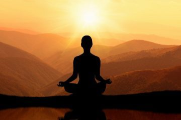 Man meditating in mountains - meditation tips