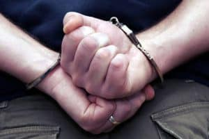 Arrested man wearing handcuffs - Nobody knows you fiction