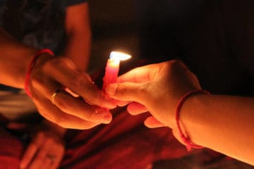 Joining hands with candle - Time for change