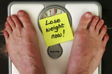 standing on scale - fat-shaming